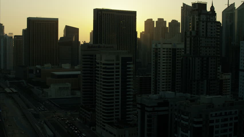 Aerial Dubai sunset City silhouette Skyscrapers UAE | Shutterstock HD Video #10292927