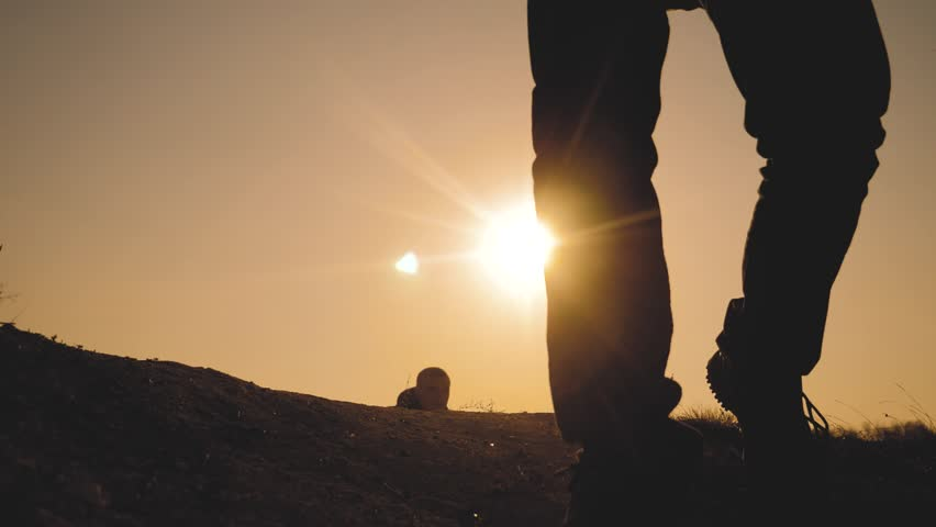lifestyle teamwork business travel concept. legs silhouette group hikers of people walking on the top of the mountain with backpacks sunset sun light. slow motion video. campaign tourists with #1029308666