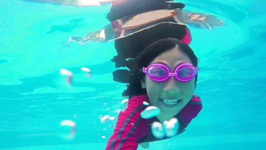 Asian girl swiming in pool, under water view. | Shutterstock HD Video #1029341366