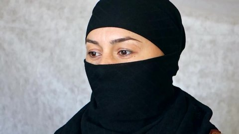 Portrait of a beautiful arab girl. An Islamic woman in a hijab looks into the camera.