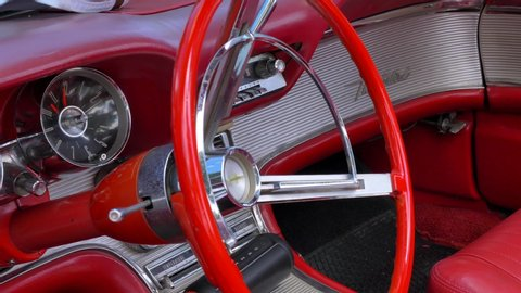 North district, Israel - May 4, 2019: View of a Classic red Ford Thunderbird roadster interior and Dashboard in mint condition parked at an open air display car meeting.
