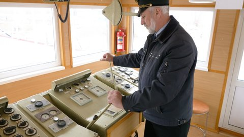 Ship Captain Demonstrate Control Devices Board. Sail Vessel Cabin Machinery Equipment Wheelhouse Navigation Devices Cargo Boat Dashboard Water Transportation Marine Fleet Concept 4K