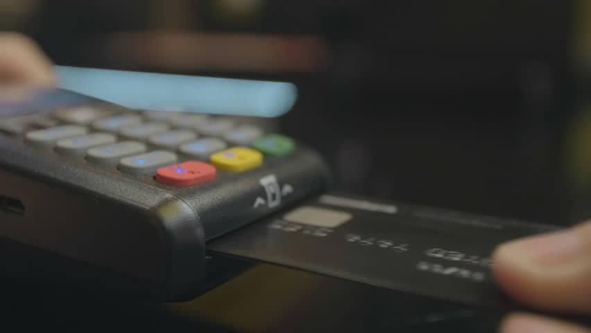 Credit card machine for money transaction. Man hand with credit card swipe through pos terminal and enter pin code. Banking services of electronic money. Financial success and safety. | Shutterstock HD Video #1029403976