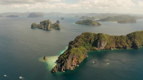 aerial view of bay with lagoons and the tropical islands. Seascape with tropical rocky islands, ocean blue water. islands and mountains covered with tropical forest. El nido, Philippines, Palawan