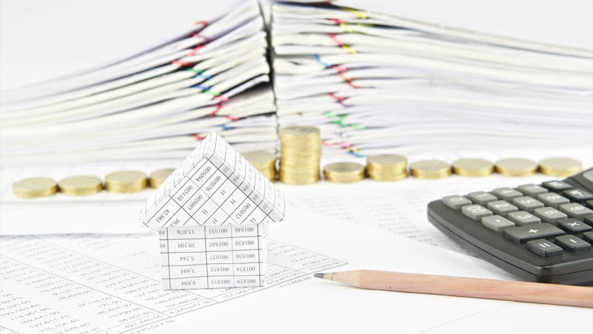 Calculate the cost and measurements of an architectural drawing house and pencil with step pile of gold coins on finance account with stack old paper malvernweather Gallery