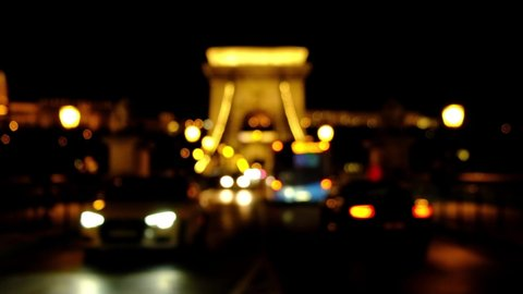Car traffic night city lights blurred bokeh background. Video of night city road. Cars and bus moving on road on bridge in night.