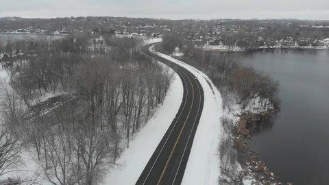 aerial footage of Highway, freeway, lake shore, winter time, Minnesota