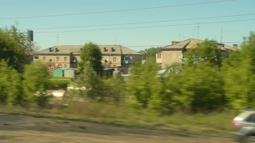 Looking at small township from moving train. Summer view, Russia | Shutterstock HD Video #1029634886
