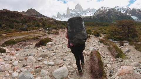 Woman Traveler with Backpack hiking in the Mountain leading to the Mount Fitz Roy, Patagonia, Argentina. 4k