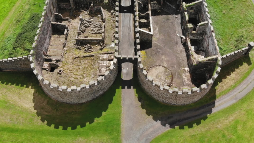 Close bird's eye view travel shot of the Downhill House ruins and visiting tourists on a sunny day | Shutterstock HD Video #1029672296