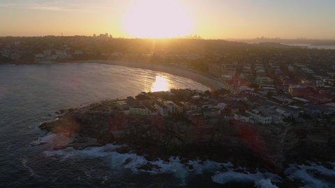 Bondi Beach Drone Shot at Sunset with Sydney CBD in background at Sunset