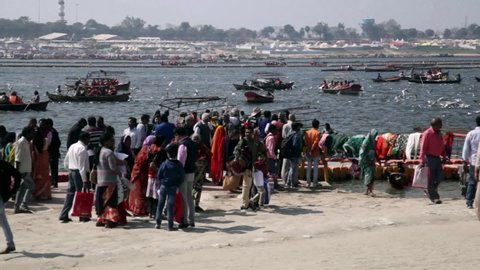 "Allahabad, Uttar Pradesh / India - February 23, 2019: People are roaming around near holy river ""The Ganges""  during the event Ardh Kumbh Mela."