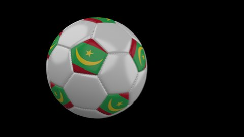 Soccer ball with flag Mauritania flies past camera, slow motion blur, 4k footage with alpha channel