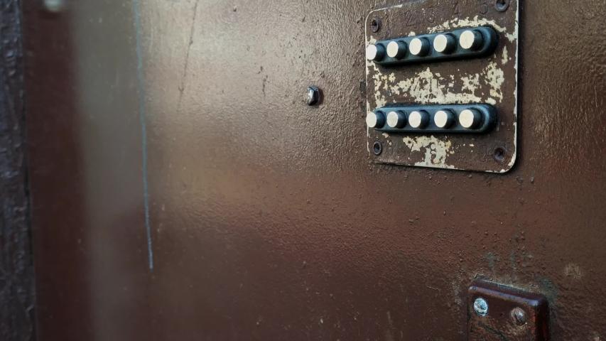 Pan down of old rustic door to door handle from Soviet time