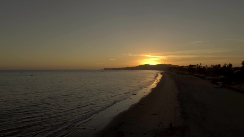 Drone flying over Santa Barbara ocean watching vibrant sunset | Shutterstock HD Video #1029895076
