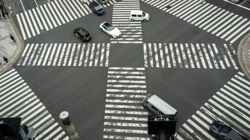 Time lapse of busy intersection in Ginza, Tokyo, Japan. Zoom out. | Shutterstock HD Video #1029924716