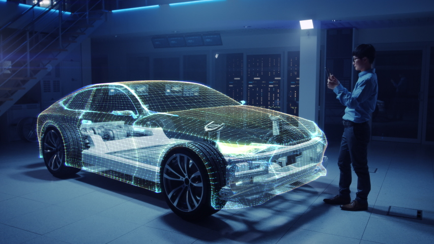 Automotive Engineer Working on Electric Car Chassis Platform, Using Tablet Computer with Augmented Reality 3D Software. Innovative Facility: Vehicle Frame with Wheels Becomes a Solid Virtual Model. | Shutterstock HD Video #1029926636