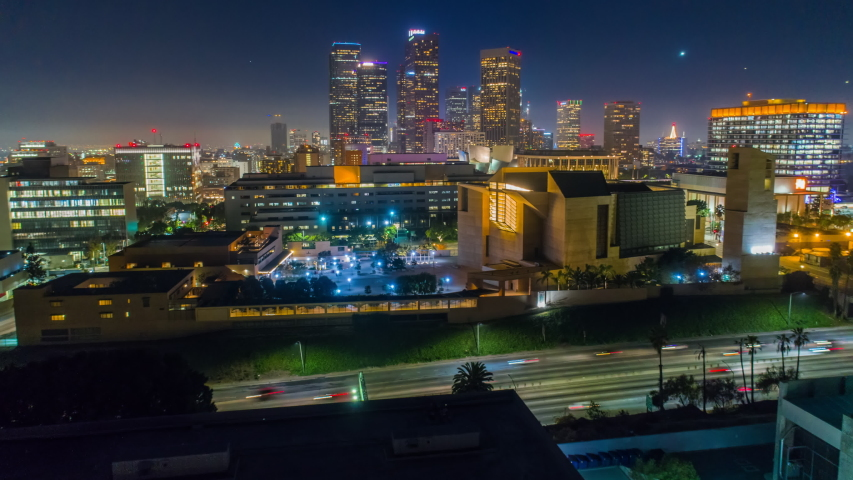Cinematic urban aerial time lapse view of downtown los angeles with freeway traffic at night  | Shutterstock HD Video #1029934406