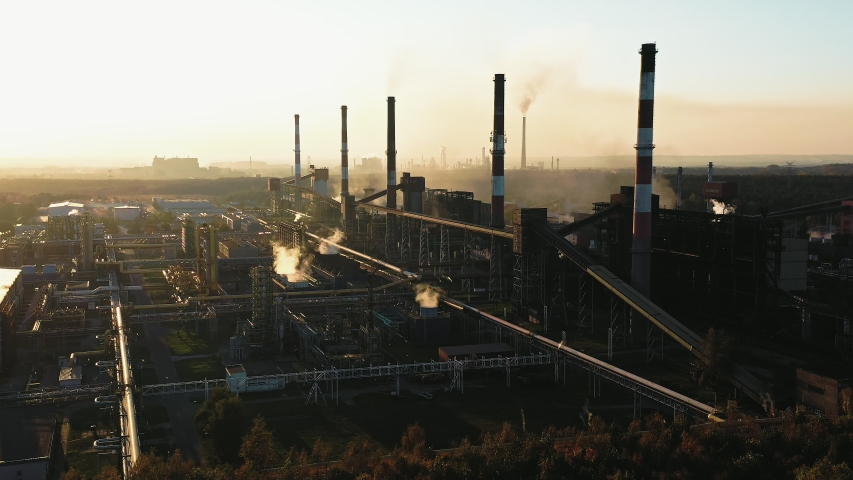Industrial landscape with heavy pollution produced by a large factory | Shutterstock HD Video #1029952766