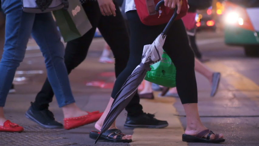 Customers with shopping bags crossing street in busiest area of Hong Kong. Crowded crosswalk. City life. | Shutterstock HD Video #1029987086