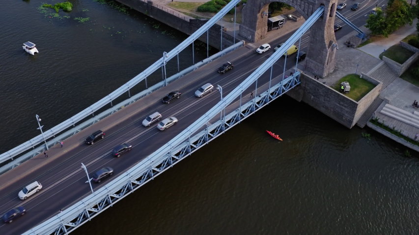Drone footage of the street traffic on the bridge. #1029996956
