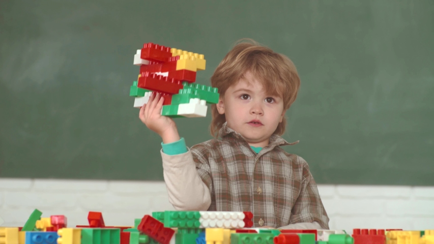 Back to school. School kids. Boy and girl from elementary school at the school yard. Cheerful smiling child at the blackboard   Shutterstock HD Video #1030042256
