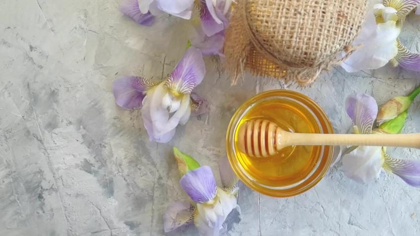 Fresh honey, flower iris, slow motion   Shutterstock HD Video #1030099916