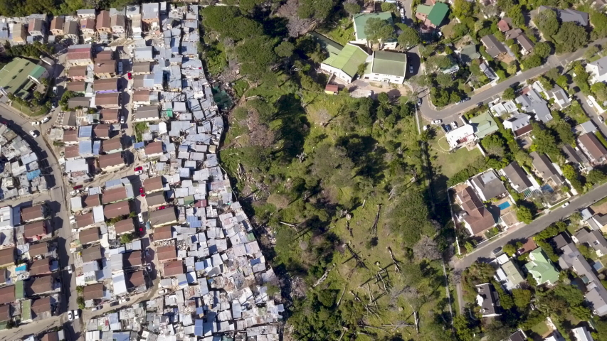 Aerial view over township and middle class houses in South Africa | Shutterstock HD Video #1030112276