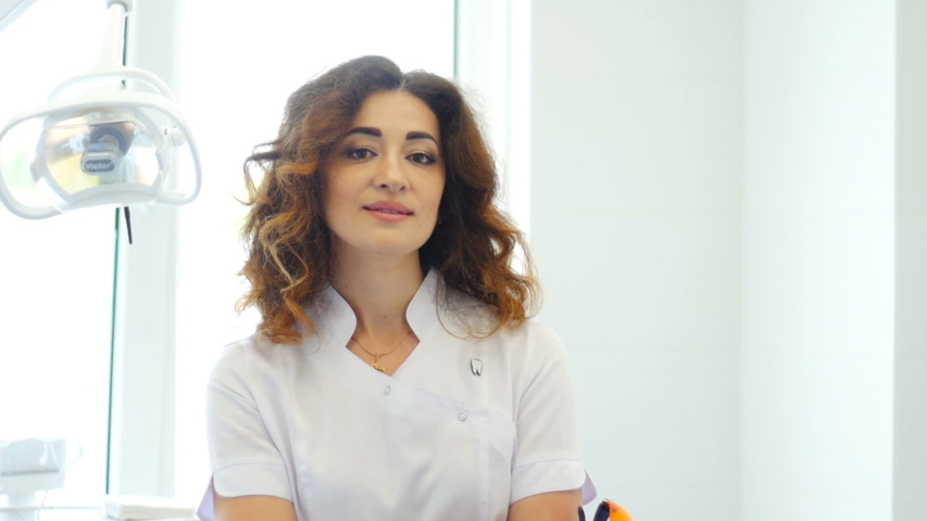 Female doctor posing for camera, confidence and professionalism, clinic | Shutterstock HD Video #1030151666