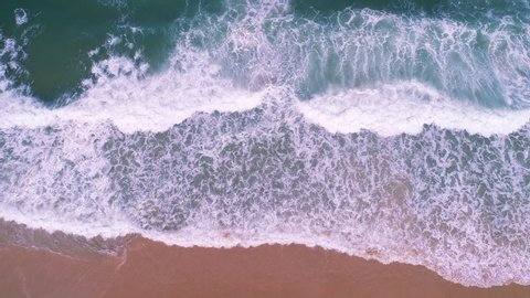 Tropical sea with wave crashing on beach aerial view drone shot Top down