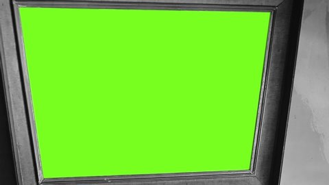 "Old Mirror or Picture Frame with Green Screen. Black and White Tone. Zoom Out. You can Replace Green Screen with the Footage or Picture you Want with ""Keying"" Effect."