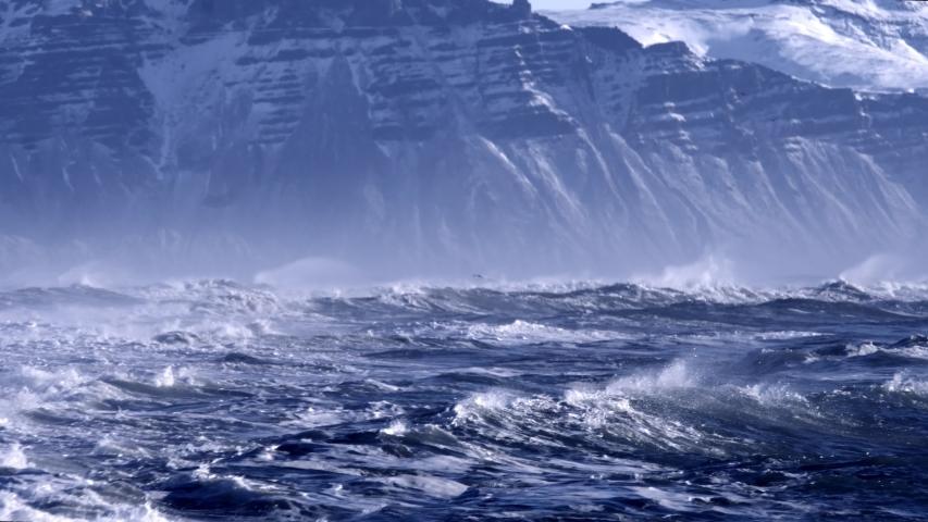 Atlantic Ocean waves splashing on mountain background   Shutterstock HD Video #1030216826