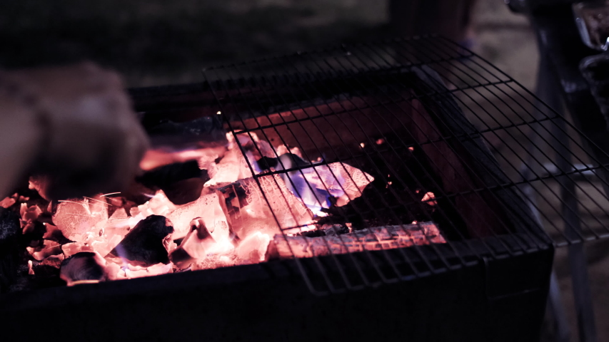 Glowing barbecue embers, fire charcoal in stove for cooking and grilling food or outdoors barbecue. Royalty high-quality free stock footage of embers burning with red and yellow flame    Shutterstock HD Video #1030223066