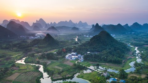 Sunset Landscape of Guilin Time-lapse , Li River and Karst mountains called Cuiping or Five Finger mount located ,Guangxi Province, China, ZO , Zoom out.