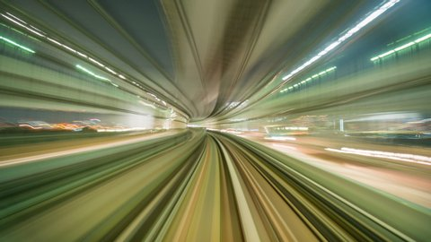 Time-lapse Light motion blur from Yurikamome Line moving inside tunnel in Tokyo, Japan.