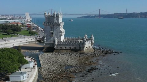Aerial view of Belem Tower (Torre de Belem or the Tower of Saint Vincent) fortified tower located in the civil parish of Santa Maria de Belem in Lisbon Portugal reveling the 25 De Abril Bridge