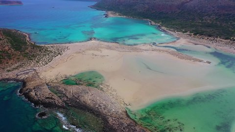 Aerial drone bird's eye view video of tropical caribbean paradise bay and lagoon with white sandy beach and turquoise clear sea