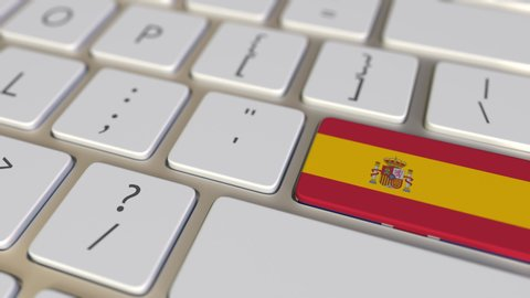 Key with flag of Spain on the computer keyboard switches to key with flag of Great Britain, translation or relocation related animation