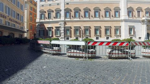 Rome terrorist attack protection. Protection forbidden passing fences restrict access to building. Fence is used by the police and guards during performances, parades and mass celebrations of citizens