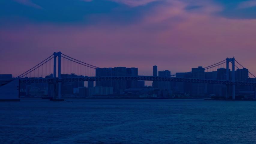 A timelapse of sunset near the bayarea at the business town panning. Kouto district Ariake Tokyo Japan - 04.18.2019 | Shutterstock HD Video #1031030816