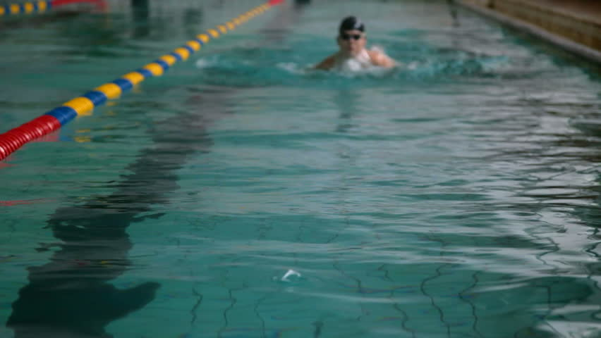 Young swimmer performing the butterfly stroke