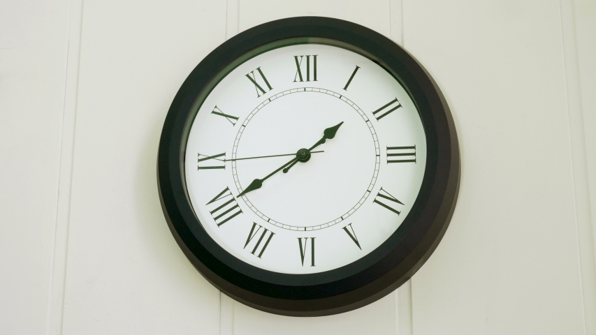 Wall clock showing what time it is. Forty one minutes past one hour p.m. 4K   Shutterstock HD Video #1031134166