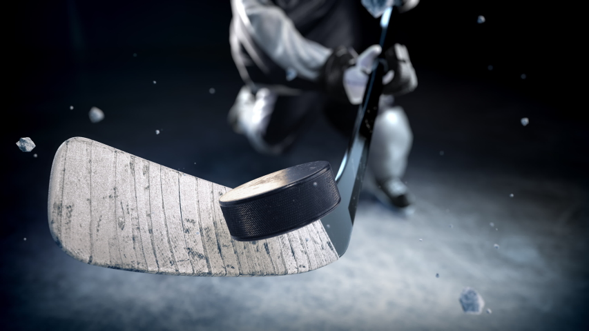 Hockey player in black uniform hits the puck in slow motion. Beautiful close-up (4k, 3840x2160, ultra high definition)   Shutterstock HD Video #1031165156