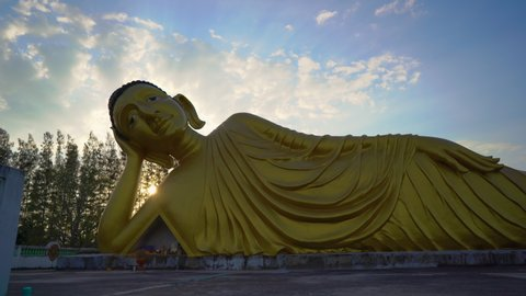 Timelapse shot of statue of the lying Buddha in the Wat Srisoonthorn temple on Phuket island, Thailand. Travel to Thailand concept