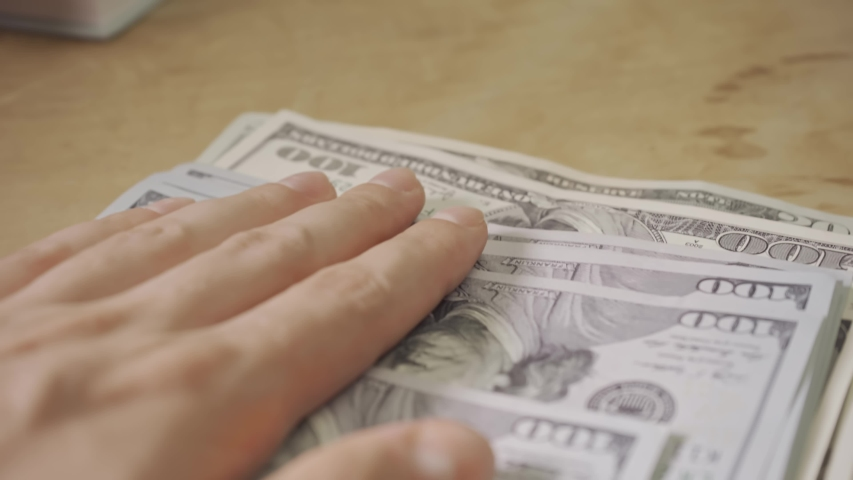 Business concept money. Saving money for future. One hundred dollar. Money is the best motivator for work. USA Inflation concept. Business bankruptcy concept. Crisis of getting into debt.