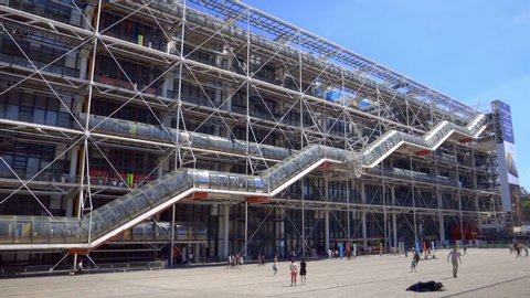 Paris, France - June 2019 :  Centre Pompidou Beaubourg in the center of Paris France, facade of the modern art and contempary museum with its famous colored pipes  and escalator on a spring day