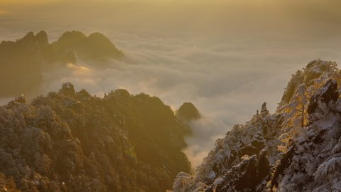 Sunrise time lapse looking out over a sea of fog at the Yellow Mountains (Huangshan) in China