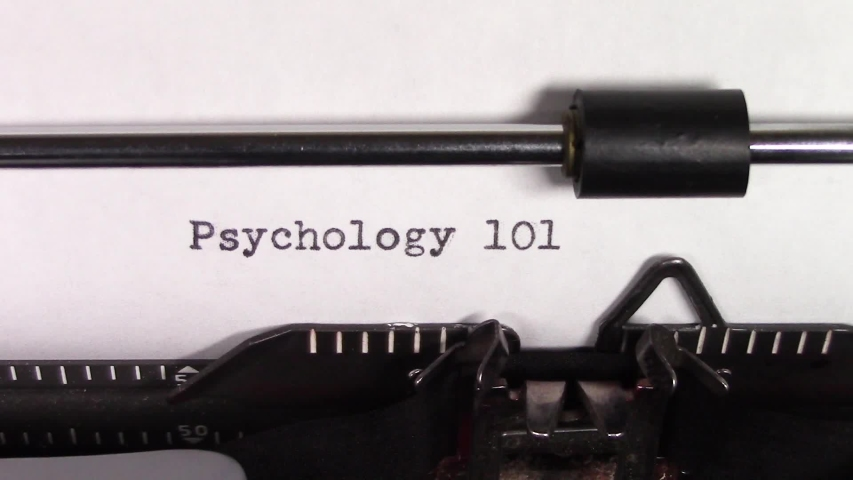 """A close up video of the words """"Psychology 101 """" being typed on white paper in an old manual typewriter. Shot in macro.   Shutterstock HD Video #1031830466"""