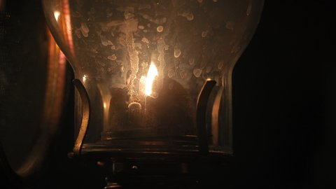 Old kerosene lamp flame dim in the night