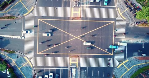 Top down view of highway intersection with zebra crossing in business district at Jakarta, Indonesia. Shot in 4k resolution from a drone flying down